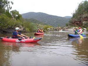 Adventurous volunteers taking a moment whilst paddling.<br/>