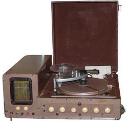 John's invention incorporated a tape recorder, a radio and a turntable with two arms that both played and cut records. Photograph by Angie Smashnuk