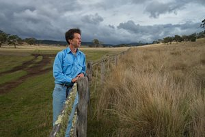 Julian von Bibra at a fenceline between pasture and native grassland. Photo Matthew Newton.