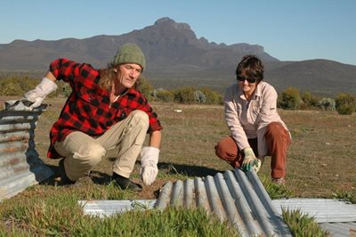 Reserve Manager Simon Smale and Ecologist Angela Sanders with reptile habitat materials. Photo Amanda Keesing.